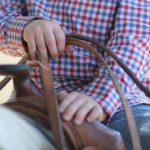 Boy in Saddle