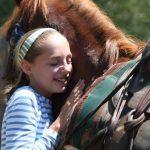 Giving horse a hug